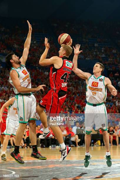 Shawn Redhage of the Wildcats lays up against Todd Blanchfield of the Crocodiles during the round 16 NBL match between the Perth Wildcats and the...