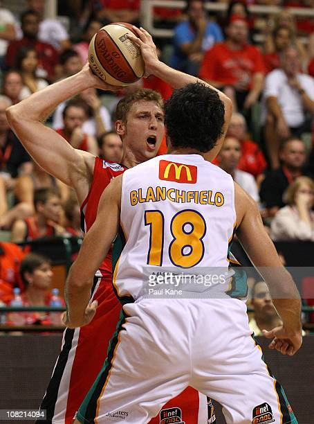 Shawn Redhage of the Wildcats looks to pass around Todd Blanchfield of the Crocodiles during the round 15 NBL match between the Perth Wildcats and...