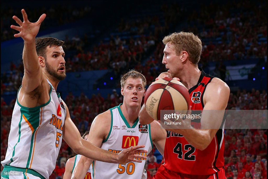 Shawn Redhage of the Wildcats looks to pass the ball against Ben Allen of the Crocodiles during the round 19 NBL match between the Perth Wildcats and the Townsville Crocodiles at Perth Arena on February 15, 2013 in Perth, Australia.