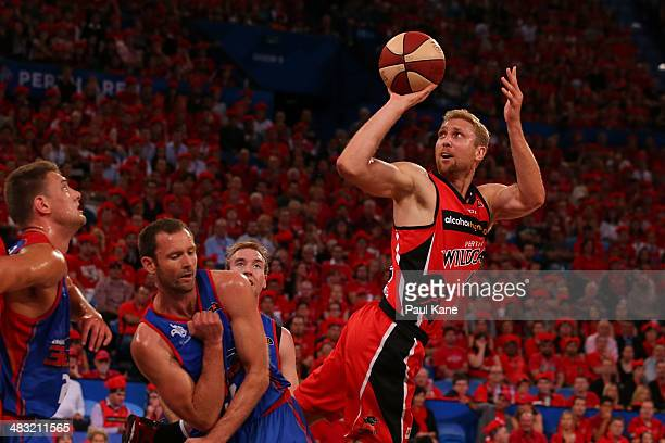 Shawn Redhage of the Wildcats takes a fade away jump shot during game one of the NBL Grand Final series between the Perth Wildcats and the Adelaide...
