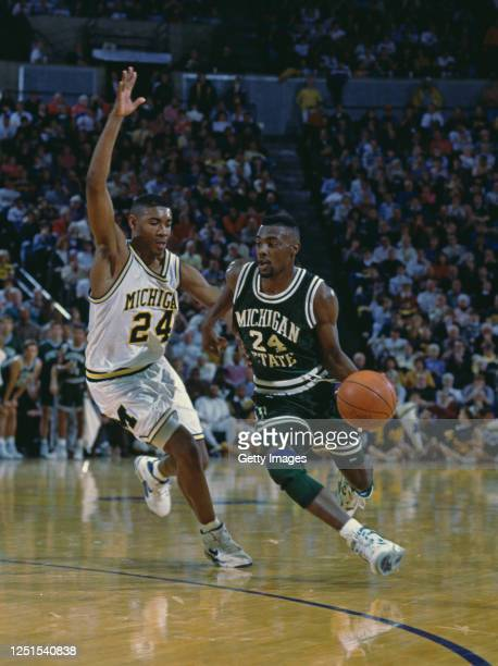 Shawn Respert, Guard for the Michigan State Spartans drives on past Jimmy King, Guard for the University of Michigan Wolverines during their NCAA...