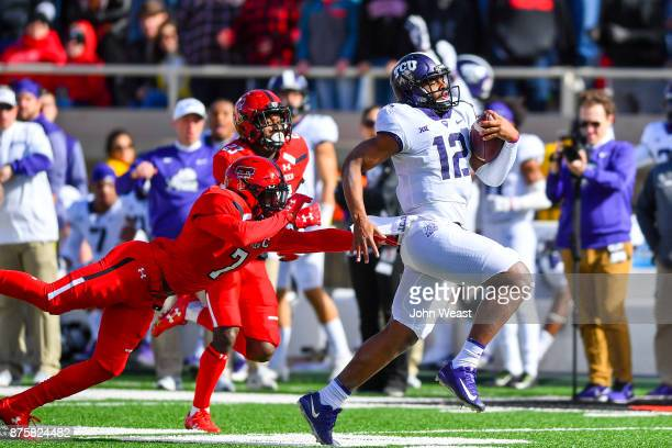 Shawn Robinson of the TCU Horned Frogs outruns Jah'Shawn Johnson of the Texas Tech Red Raiders during the first half of the game on November 18 2017...