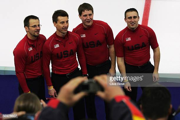 Shawn Rojeski Pete Fenson John Shuster and Joe Polo of United States celebrate after defeating Great Britain in the bronze medal match of the men's...
