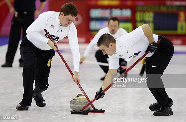Shawn Rojeski watches his stone head for the house as John Shuster and Joe Polo of the United States sweep to adjust its path during a preliminary...