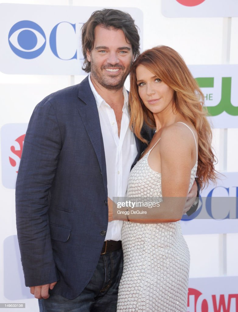 Shawn Sanford (L) and actress Poppy Montgomery arrive at the CBS, Showtime and The CW 2012 TCA summer tour party at 9900 Wilshire Blvd on July 29, 2012 in Beverly Hills, California.