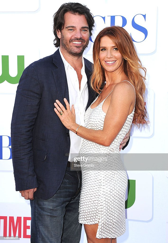 Shawn Sanford (L) and Poppy Montgomery arrives at the 2012 TCA Summer Tour - CBS, Showtime And The CW Party at 9900 Wilshire Blvd on July 29, 2012 in Beverly Hills, California.