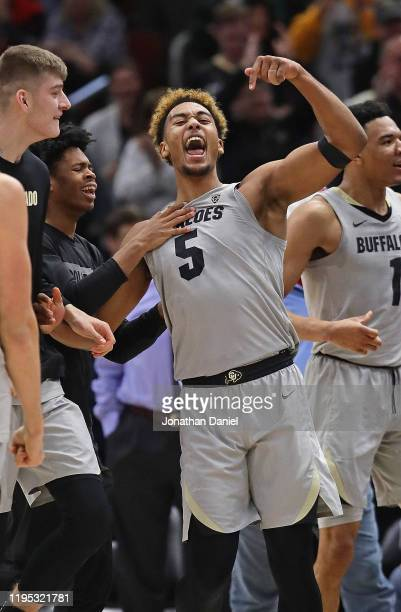 Shawn Schwartz of the Colorado Buffaloes celebrates after hitting the game-winning shot against the Dayton Flyers at the United Center on December...