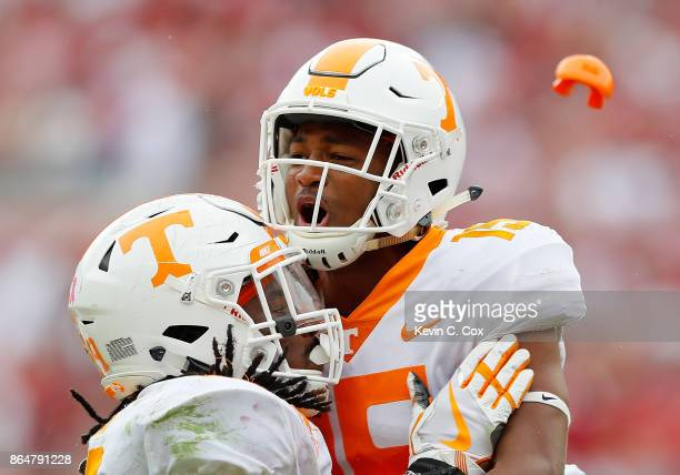Shawn Shamburger of the Tennessee Volunteers loses his mouthguard as he reacts to a fumble by Irv Smith Jr #82 of the Alabama Crimson Tide into the...