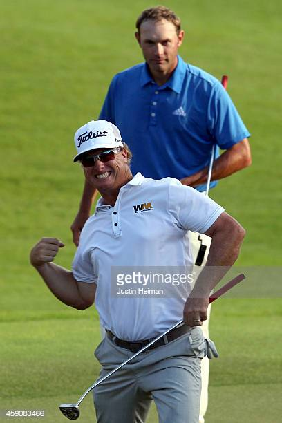 Shawn Stefani looks on as Charley Hoffman of the United States celebrates after putting out on the 18th hole to win the final round of the OHL...