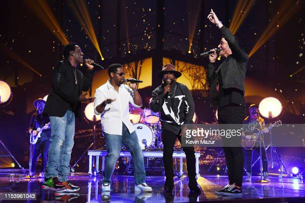 Shawn Stockman Nathan Morris and Wanya Morris of Boyz II Men and Brett Young perform at the 2019 CMT Music Awards at Bridgestone Arena on June 05...