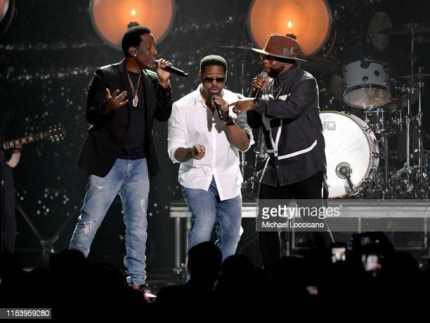 Shawn Stockman Nathan Morris and Wanya Morris of Boyz II Men perform at the 2019 CMT Music Awards at Bridgestone Arena on June 05 2019 in Nashville...