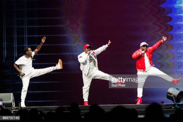 Shawn Stockman Nathan Morris and Wanya Morris of Boyz II Men perform during 'The Total Package Tour' at KeyArena on June 7 2017 in Seattle Washington