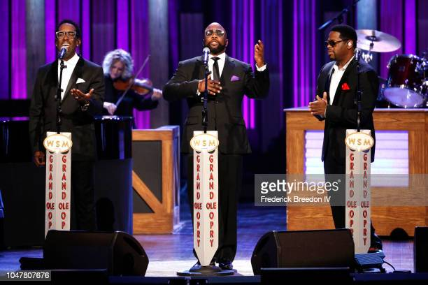 Shawn Stockman Wanya Morris and Nathan Morris of musical group Boyz II Men perform onstage during An Opry Salute to Ray Charles at The Grand Ole Opry...