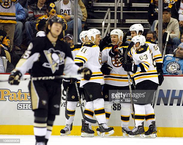Shawn Thornton of the Boston Bruins celebrates his third period goal with teammates against the Pittsburgh Penguins at Consol Energy Center on...