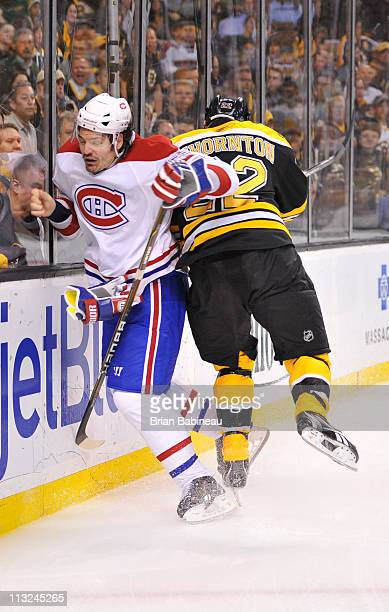 Shawn Thornton of the Boston Bruins checks against Brent Sopel of the Montreal Canadiens in Game Five of the Eastern Conference Quarterfinals during...