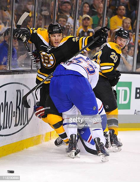 Shawn Thornton of the Boston Bruins checks against Ryan White of the Montreal Canadiens in Game Seven of the Eastern Conference Quarterfinals during...