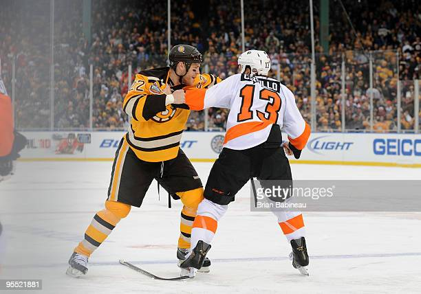 Shawn Thornton of the Boston Bruins fights against Dan Carcillo of the Philadelphia Flyers in the 2010 Bridgestone Winter Classic at Fenway Park on...