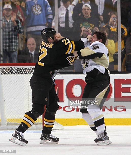 Shawn Thornton of the Boston Bruins fights with Matt Cooke of the Pittsburgh Penguins at the TD Garden on March 18 2010 in Boston Massachusetts