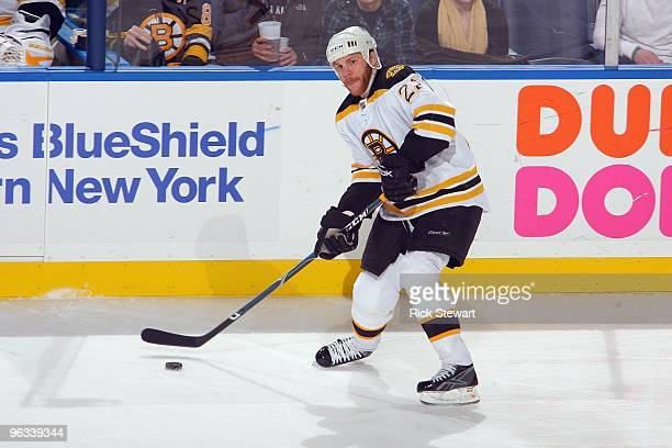 Shawn Thornton of the Boston Bruins handles the puck against the Buffalo Sabres at HSBC Arena on January 29 2010 in Buffalo New York