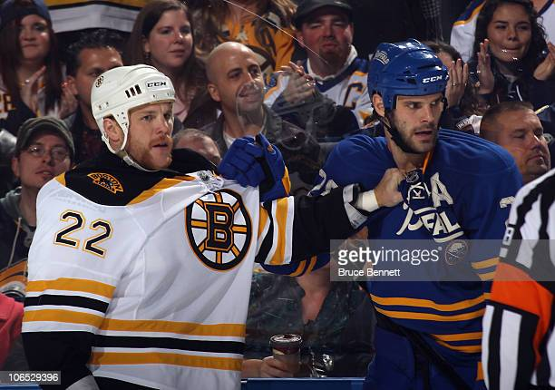 Shawn Thornton of the Boston Bruins hangs on to Paul Gaustad of the Buffalo Sabres at the HSBC Arena on November 3 2010 in Buffalo New York The...
