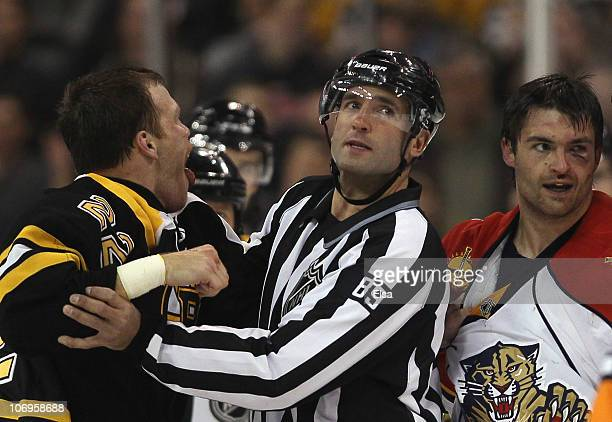 Shawn Thornton of the Boston Bruins is pulled away from Darcy Hordichuk of the Florida Panther by linesman Steve Miller on November 18 2010 at the TD...