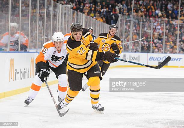 Shawn Thornton of the Boston Bruins shoots the puck against the Philadelphia Flyers in the 2010 Bridgestone Winter Classic at Fenway Park on January...