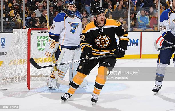 Shawn Thornton of the Boston Bruins watches the play against the St Louis Blues at the TD Garden on November 6 2010 in Boston Massachusetts