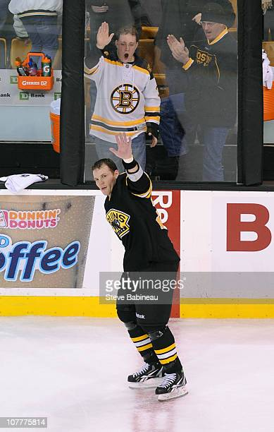 Shawn Thornton of the Boston Bruins waves to the fans after the game against the Atlanta Thrashers at the TD Garden on December 23 2010 in Boston...