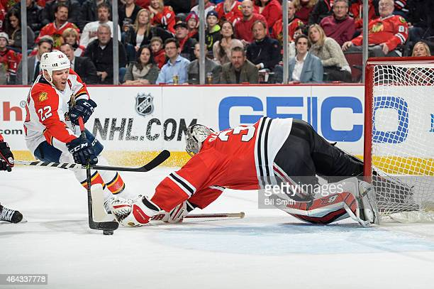 Shawn Thornton of the Florida Panthers attempts to score on goalie Scott Darling of the Chicago Blackhawks during the NHL game at the United Center...