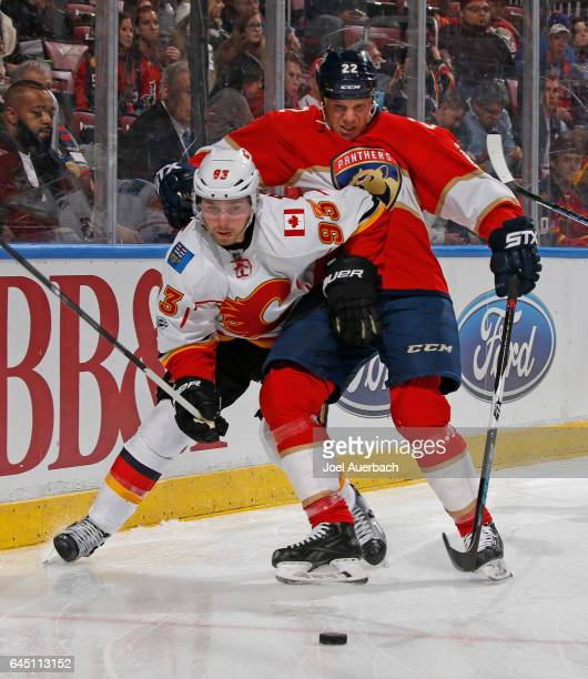 Shawn Thornton of the Florida Panthers checks Sam Bennett of the Calgary Flames as he attempts to chase a loose puck during second period action at...