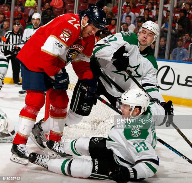 Shawn Thornton of the Florida Panthers tangles with Jiri Hudler and teammate Devin Shore of the Dallas Stars at the BBT Center on March 4 2017 in...