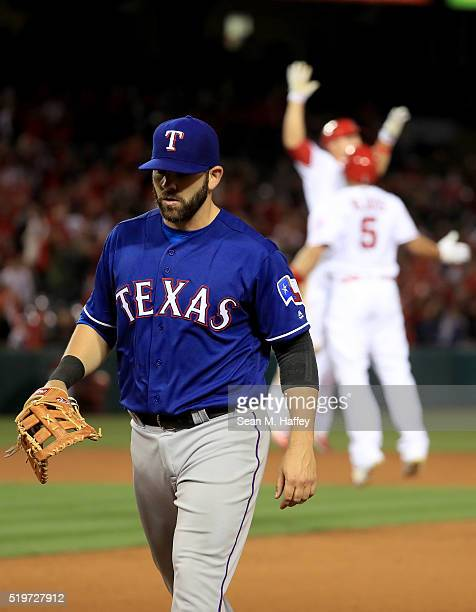 Shawn Tolleson of the Texas Rangers walks off the field after Albert Pujols of the Los Angeles Angels of Anaheim hit a game winning RBI during the...