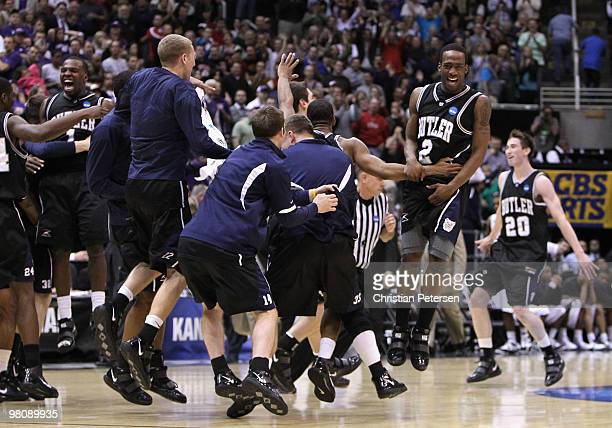 Shawn Vanzant of the Butler Bulldogs celebrates with teammates after defeating the Kansas State Wildcats in the west regional final of the 2010 NCAA...