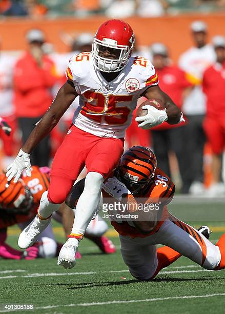 Shawn Williams of the Cincinnati Bengals attempts to tackle Jamaal Charles of the Kansas City Chiefs during the second quarter of the game at Paul...