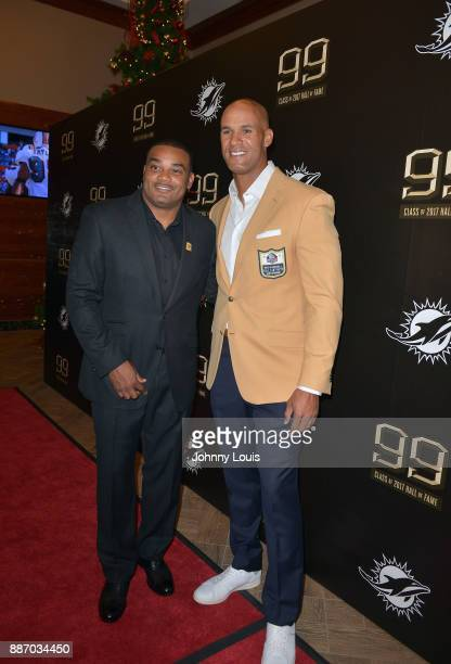 Shawn Wooden and Jason Taylor attend The Miami Dolphins 'Hall of Fame Celebration' hosting Jason Taylor at Hard Rock Stadium on December 02 2017 in...