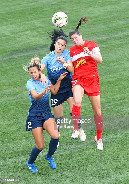 Shawna Gordon and Jonelle Filigno of Sky Blue FC battle for a loose ball with Brittany Taylor of Western New York Flash during the second half at...