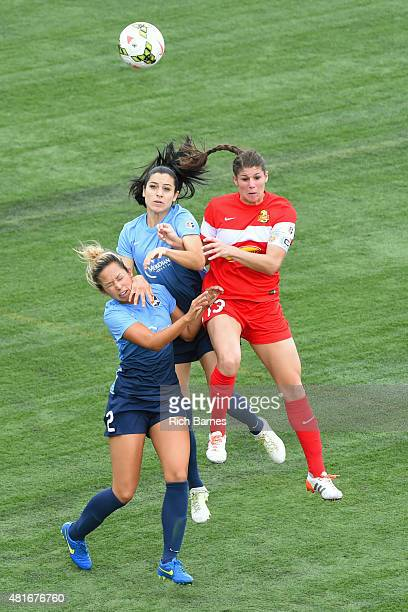 Shawna Gordon and Jonelle Filigno of the Sky Blue FC battle for a loose ball with Brittany Taylor of the Western New York Flash during the second...