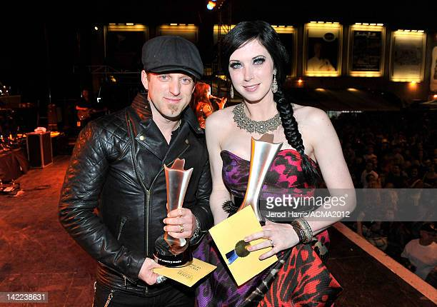 Shawna Thompson and Keifer Thompson of the music duo Thompson Square pose with the award for Vocal Duo of the Year backstage at the ACM concert...