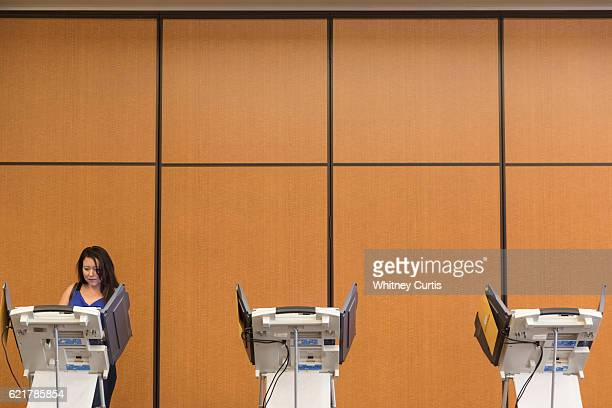 Shawna Vandevelde casts her electronic ballot on November 8 2016 in Olathe Kansas After a contentious campaign season Americans go to the polls today...