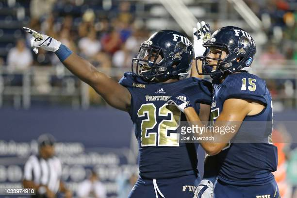 Shawndarrius Phillips of the Florida International Panthers celebrates his first quarter touchdown with Austin Maloney against the UMass Minutemen...