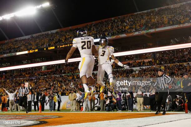 Shawne Alston and Stedman Bailey of the West Virginia Mountaineers celebrate after Alston rushds for a 4yard touchdown in the first quarter against...