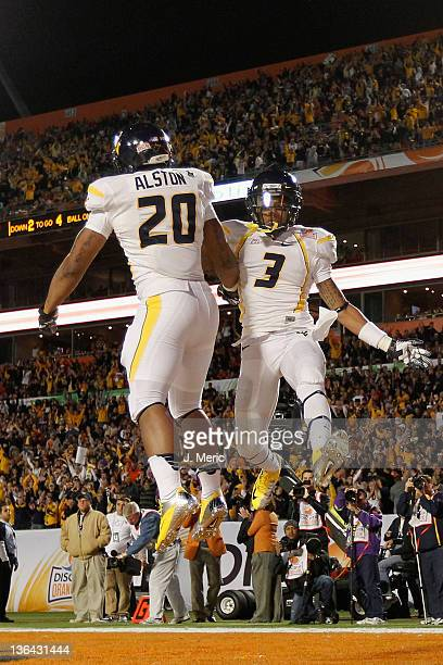 Shawne Alston and Stedman Bailey of the West Virginia Mountaineers celebrate after Alston rushds for a 4-yard touchdown in the first quarter against...