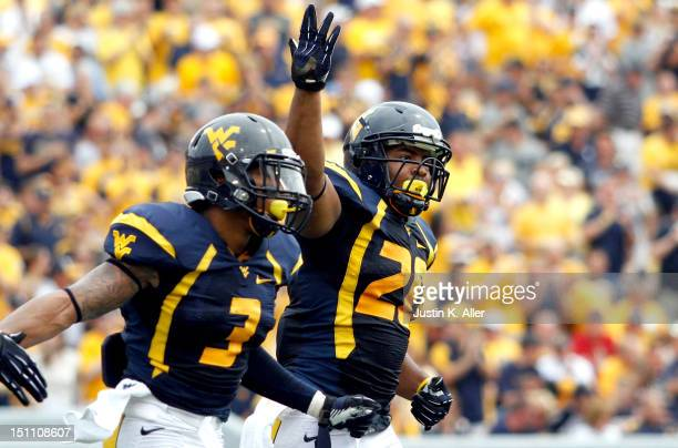Shawne Alston of the West Virginia Mountaineers celebrates after his first quarter touchdown against the Marshall Thundering Herd during the game on...