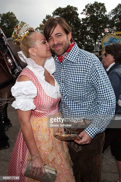 Shawne Fielding and her boyfriend Patrick Schoepf attend the 'Sixt Damen Wiesn' at Marstall tent during Oktoberfest at Theresienwiese on September 22...
