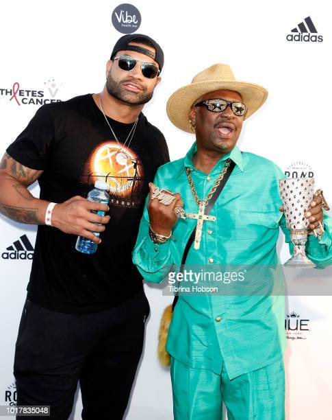 Shawne Merriman and Donald Campbell aka Bishop Don 'Magic' Juan attend the 5th annual Athletes vs Cancer Celebrity Flag Football Game on August 12...