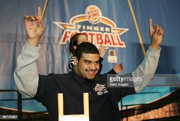 Shawne Merriman of the San Diego Chargers celebrates at The BURGER KING Finger Football Challenge at PLAYERS INC Live during the NFL Experience on...