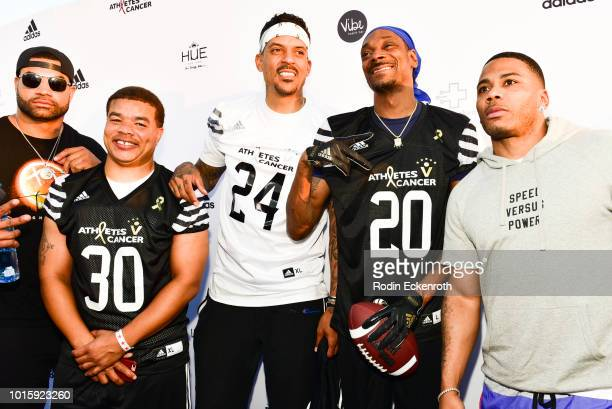 Shawne Merriman Red Grant Matt Barnes Snoop Dogg and Nelly arrive at the 5th Annual Athletes vs Cancer Celebrity Flag Football Game at Fairfax High...