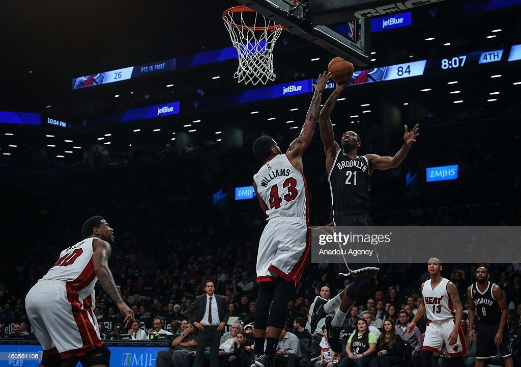 Shawne Williams #43 of Miami Heat vies with Cory Jefferson #21 of Brooklyn Nets during a basketball game between Miami Heat and Brooklyn Nets at the Barclays Center on December 16, 2014 in the Brooklyn Borough of New York City.