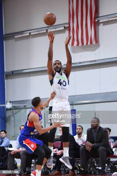 Shawne Williams of the Iowa Wolves shoots the ball against the Grand Rapids Drive NBA G League Showcase Game 20 between the Grand Rapids Drive and...