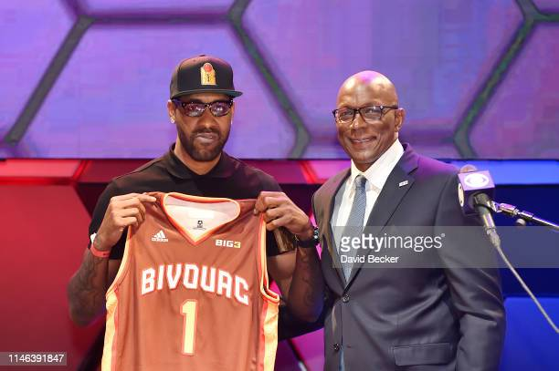 Shawne Williams poses with BIG3 Commissioner Clyde Drexler after being drafted at by the Bivouac in the first round during the BIG3 Draft at the...